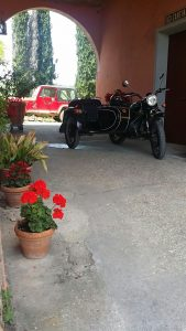 Florence vintage sidecar tour - sidecar parked at the wine estate during a chianti wine and food sidecar tour